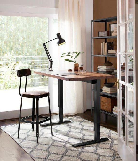 This height-adjustable desk plugs into a standard outlets.<span>Shop it here</span>.