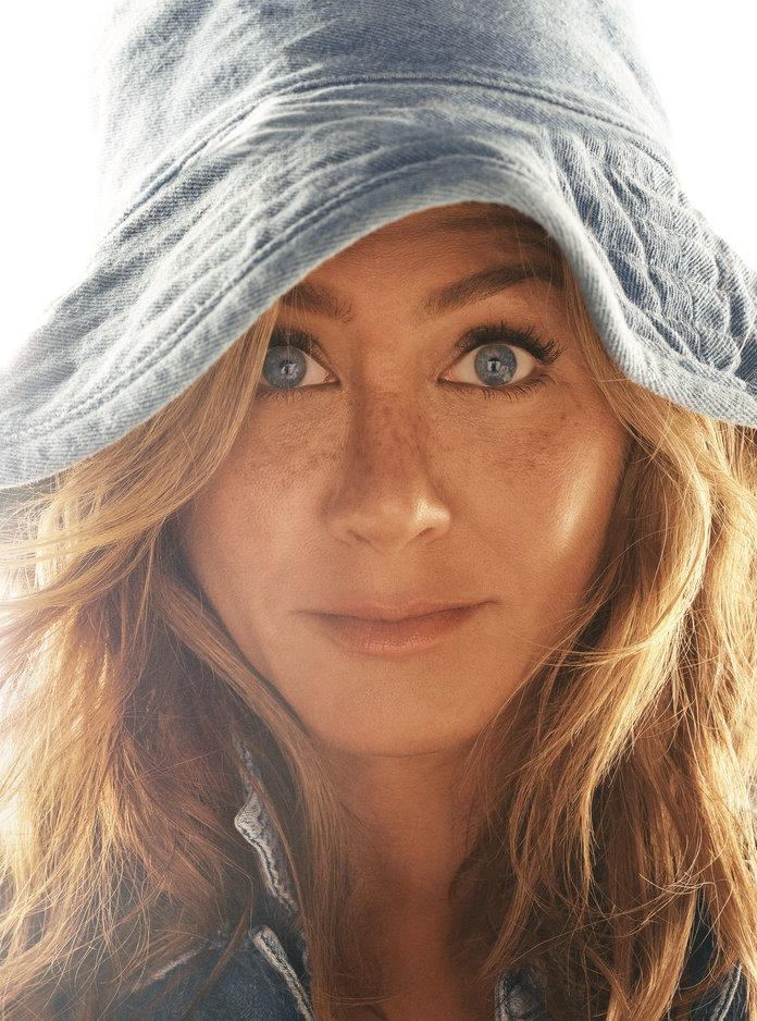 <p>Aniston in a B Sides jacket, a&nbsp;Levi's shirt, and a Hat Attack hat. Photographed by Michael Thompson.</p>