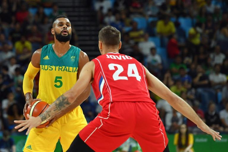Patty Mills (left) is among four Australia players who have won NBA crowns