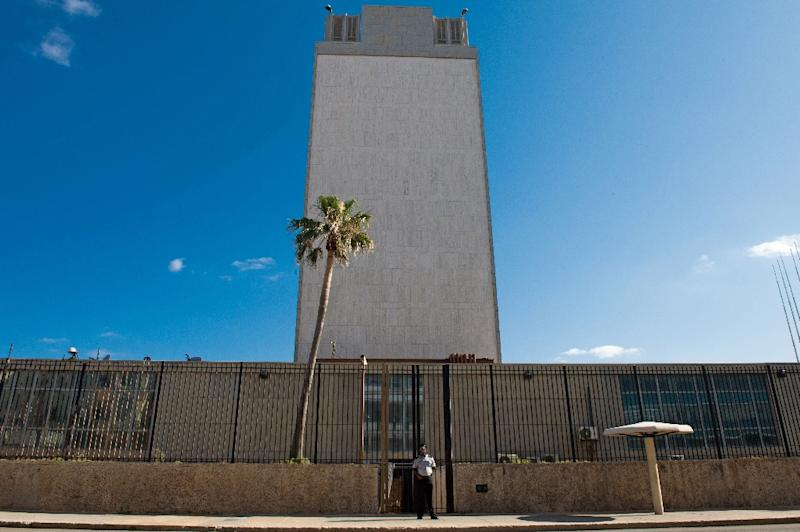 A man stands outside the US Interest Office in Havana, on December 18, 2014