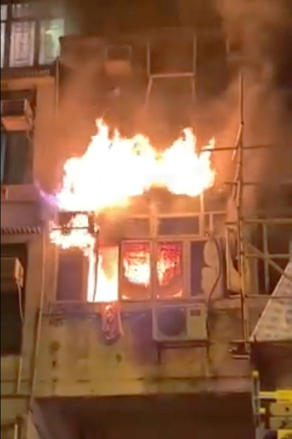 A video screen grab of the fire that broke out at the junction of Canton Road and Saigon Street. Photo: SCMP Pictures