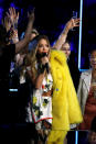 <p>A floral get-up paired with a bright yellow fur coat was one of the singer's more, erm, demure looks during the evening. <em>[Photo: Getty]</em> </p>