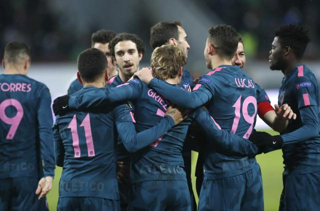 Atletico players celebrate their victory during the Europa League, round of 16 second leg soccer match between Lokomotiv Moscow and Atletico Madrid, in Moscow, Russia, Thursday, March 15, 2018. (AP Photo/Pavel Golovkin)