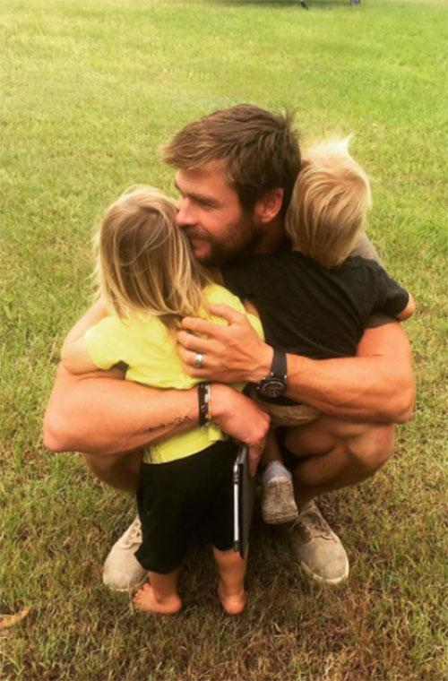 If you thought Chris Hemsworth couldn't get any hotter, wait until you see him with his kids! The Thor star and wife Elsa Pataky are proud parents to twin boys Sasha and Tristan, as well as daughter India.