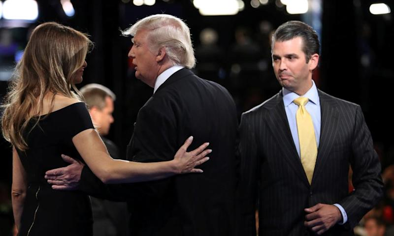 Donald Trump Jr watches his father hug wife Melania after a presidential debate at Hofstra University in Hempstead, New York last September.