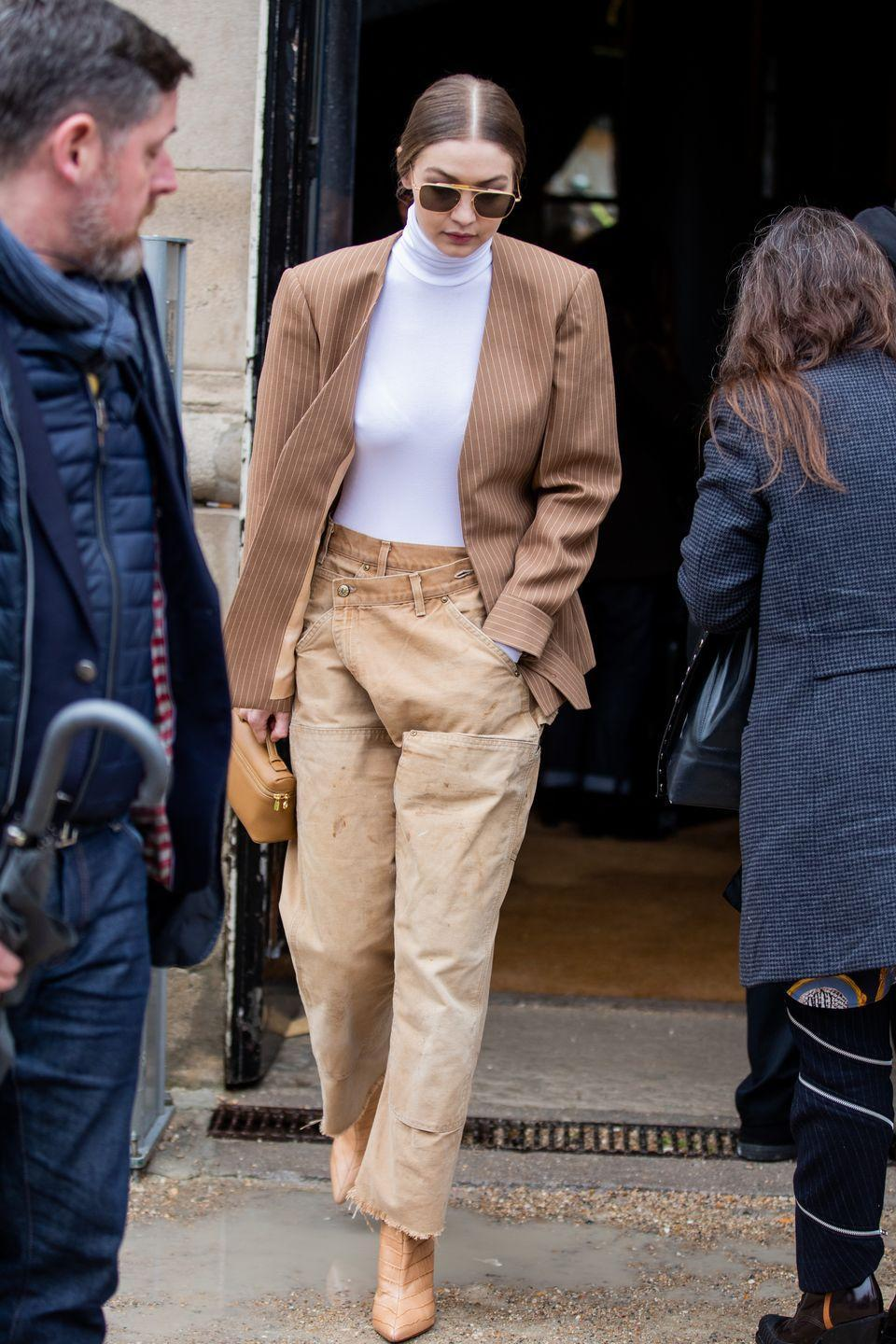 <p>Layering sandy earth tones is one of Instagram's biggest style aesthetics atm. But all that khaki needs a little help to not come off boring – thankfully, ya girl Gigi knows that texture is key. </p>