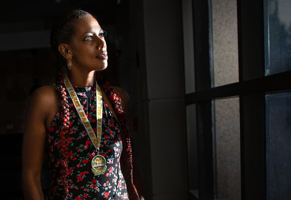 "Taloma Miller wears one of Semaj's basketball medals. <span class=""copyright"">(Jason Armond / Los Angeles Times)</span>"