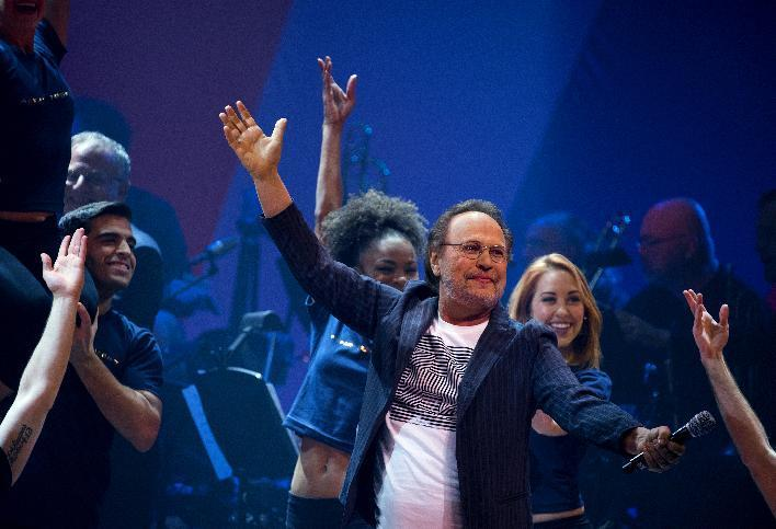 Entertainer Billy Crystal performs the opening number during a benefit concert for the Hillary Victory Fund Monday, Oct. 17, 2016, in New York. (AP Photo/Craig Ruttle)