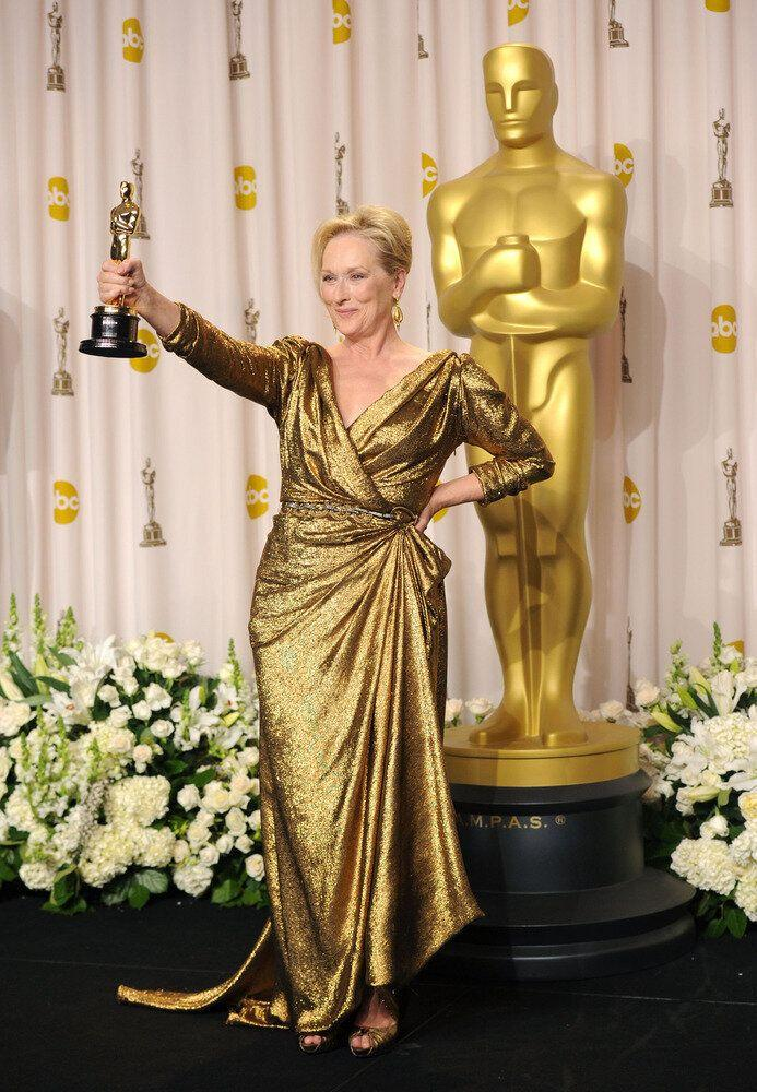 Showing off her award for Best Actress at the 84th annual Academy Awards.