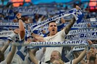 Finland fans cheer on their team against Belgium in Russia