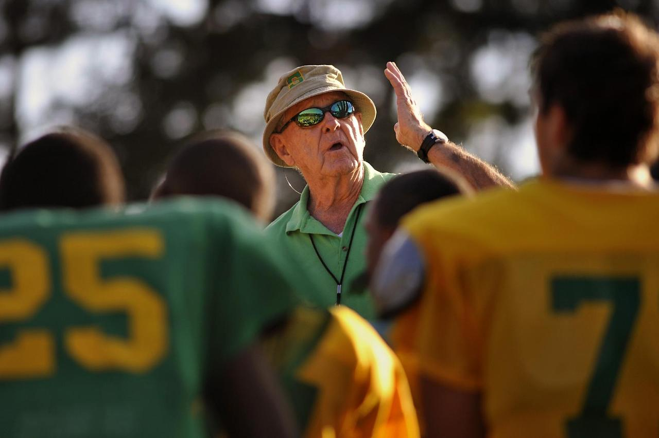 In this Oct. 24, 2012 photo, Summerville High School coach John McKissick coaches his team during practice in Summerville, S.C. McKissick is on the verge of his latest milestone in a career full of them, a game away from his 600th football win. (AP Photo/Stephen Morton)