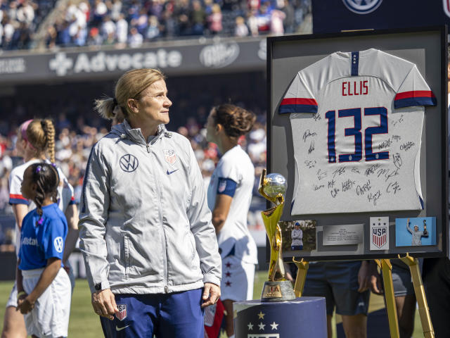 Jill Ellis watches a video tribute during a ceremony before her final game as USWNT head coach. (Getty)