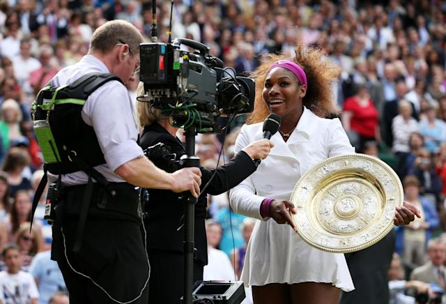 LONDON, ENGLAND - JULY 07: Serena Williams of the USA holds the winners trophy and celebrates whilst speaking to Sue Barker after her Ladies? Singles final match against Agnieszka Radwanska of Poland on day twelve of the Wimbledon Lawn Tennis Championships at the All England Lawn Tennis and Croquet Club on July 7, 2012 in London, England. (Photo by Julian Finney/Getty Images)