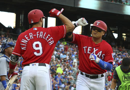 Texas Rangers Isiah Kiner-Falefa (9) bumps elbows with Shin-Soo Choo (17), who hit a solo home run during the first inning of a baseball game against the Kansas City Royals on Friday, May 25, 2018, in Arlington, Texas. (AP Photo/Richard W. Rodriguez)