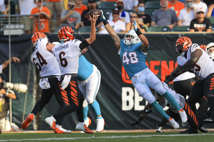 Miami Dolphins linebacker Calvin Munson (48) deflects a pass for a two-point conversion by Cincinnati Bengals quarterback Kyle Shurmur (6) in the second half of an NFL exhibition football game in Cincinnati, Sunday, Aug. 29, 2021. (AP Photo/Aaron Doster)