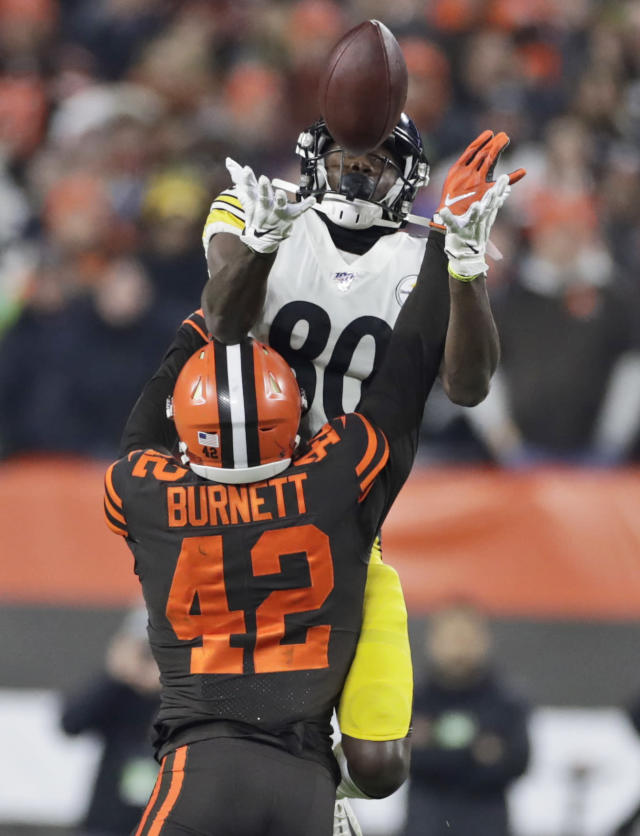 Cleveland Browns strong safety Morgan Burnett (42) breaks up a pass intended for Pittsburgh Steelers wide receiver Johnny Holton (80) during the first half of an NFL football game, Thursday, Nov. 14, 2019, in Cleveland. (AP Photo/Ron Schwane)