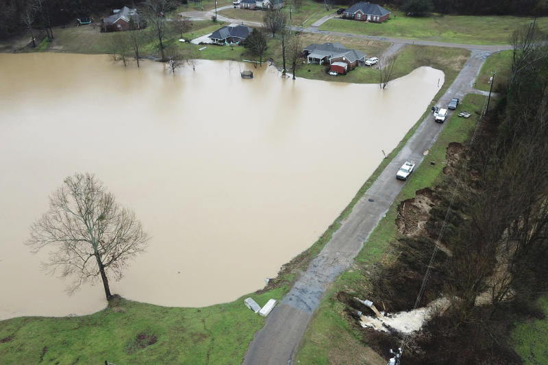 FILE - In this Feb. 11, 2020, file, aerial drone photo provided by the Mississippi Emergency Management Agency shows a potential dam/levee failure in the Springridge Place subdivision in Yazoo County, Miss. Heavy rains and recent flooding across the Southeastern U.S. have highlighted a potential public safety concern for some dams. An Associated Press review has identified hundreds of high hazard dams in the South that lack formal emergency action plans. (David Battaly/Mississippi Emergency Management Agency via AP, File)
