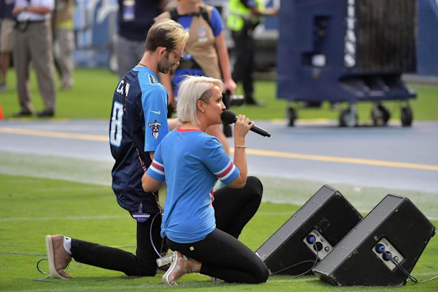 <p>Recording artist Meghan Linsey kneels after singing the national anthem before the game between the Tennessee Titans and the Seattle Seahawks at Nissan Stadium. Mandatory Credit: Jim Brown-USA TODAY Sports </p>