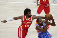 Brooklyn Nets forward Kevin Durant, right, is defended by Atlanta Hawks' Solomon Hill (18) during the first half of an NBA basketball game Wednesday, Jan. 27, 2021, in Atlanta. (AP Photo/Brynn Anderson)
