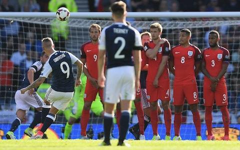 Leigh Griffiths scores the first of two sensational free-kicks against England last June - Credit: Mike Hewitt/Getty Images