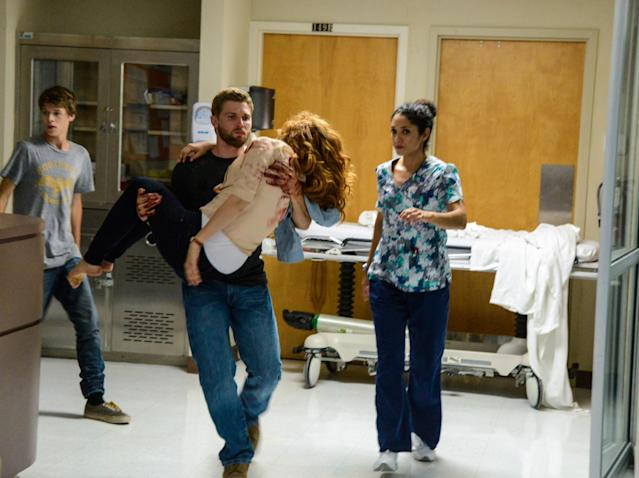 """Speak of the Devil"" - Joe (Colin Ford) helps Barbie (Mike Vogel) brings Julia (Rachelle Lefevre) to the clinic when she is wounded on ""Under the Dome."""