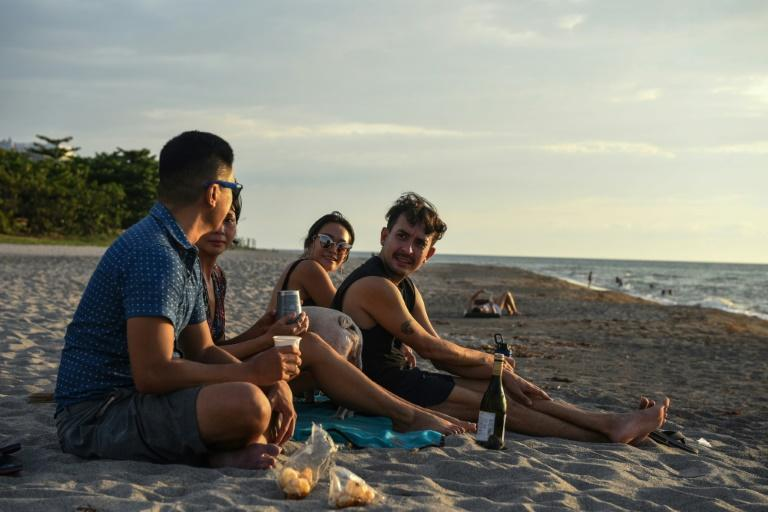 Digital nomads flocking to beach towns are helping the Philippines' tourism industry that has been devastated by curbs on foreign and domestic tourism