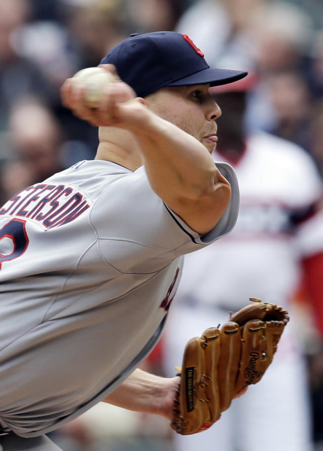 Cleveland Indians starter Justin Masterson throws against the Chicago White Sox during the first inning of a baseball game in Chicago on Saturday, April 12, 2014. (AP Photo/Nam Y. Huh)