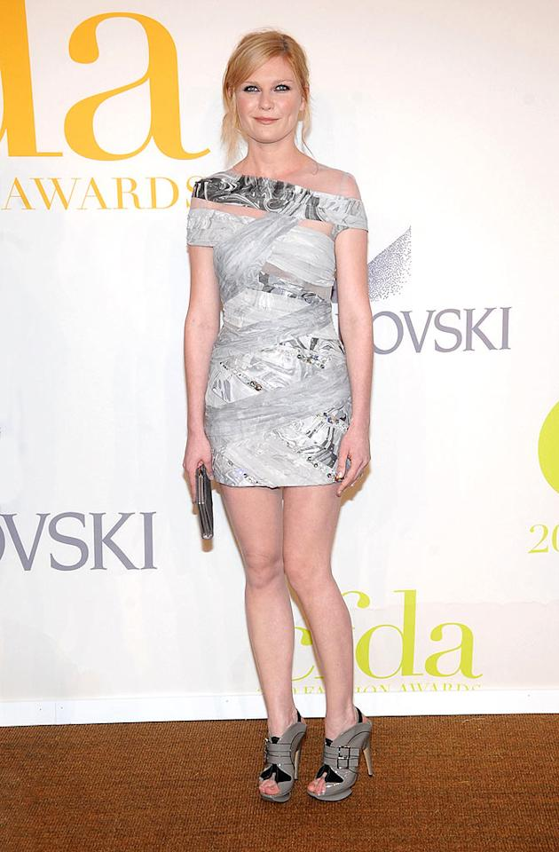 "Kirsten Dunst took a risk by sporting this edgy Rodarte frock, along with a messy 'do and grey patent leather heels to the CFDA Fashion Awards. But, judging by the look on her face, we're guessing she finally realized her look was lousy. Jamie McCarthy/<a href=""http://www.wireimage.com"" target=""new"">WireImage.com</a> - June 15, 2009"