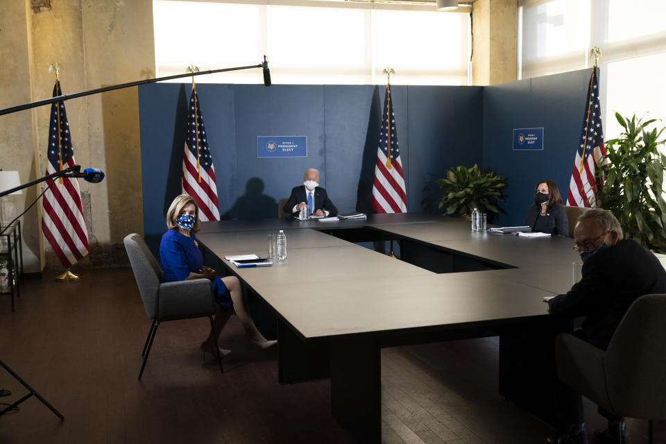 President-elect Joe Biden, speaks during a meeting with Vice President-elect Kamala Harris, right, Senate Minority Leader Chuck Schumer of N.Y., and House Speaker Nancy Pelosi of Calif., left, Friday, Nov. 20, 2020, in Wilmington, Del. (AP Photo/Alex Brandon)