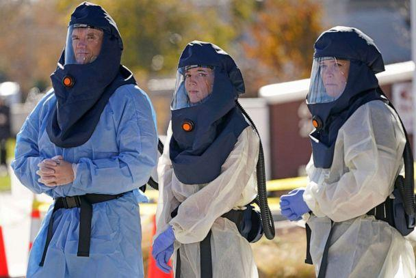 PHOTO: Salt Lake County Health Department public health nurses look on during coronavirus testing outside the Salt Lake County Health Department, Nov. 12, 2020, in Salt Lake City. (Rick Bowmer/AP)