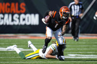 Cincinnati Bengals wide receiver Ja'Marr Chase (1) runs after a catch in front of Green Bay Packers cornerback Jaire Alexander (23) in the second half of an NFL football game in Cincinnati, Sunday, Oct. 10, 2021. (AP Photo/AJ Mast)
