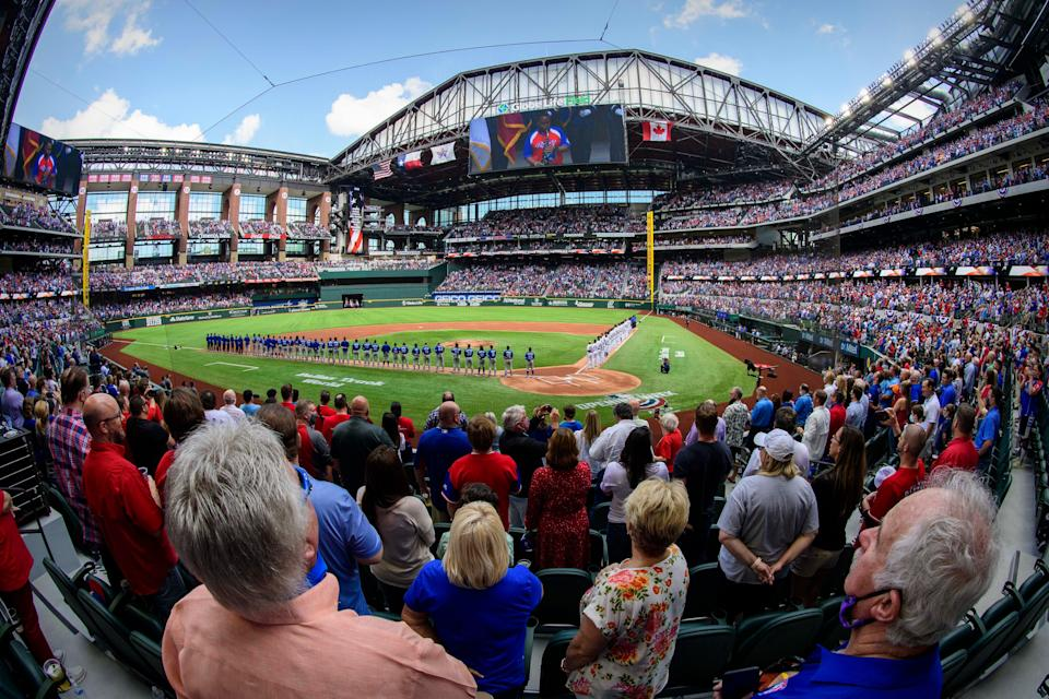 A view of the fans and the stands during the playing of the Canadian and U.S. national anthems before the game between the Texas Rangers and the Toronto Blue Jays at Globe Life Field. The Rangers opened their stadium for 100% attendance, the first such sporting event since the start of the coronavirus pandemic in March 2020.