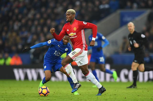 <p>Manchester United's French midfielder Paul Pogba (L) runs with the ball during the English Premier League football match between Leicester City and Manchester United at King Power Stadium in Leicester, central England on February 5, 2017. </p>