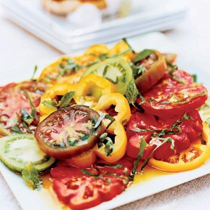 """<p>This marinated heirloom tomato <a href=""""https://www.myrecipes.com/salad-recipes/"""" rel=""""nofollow noopener"""" target=""""_blank"""" data-ylk=""""slk:salad"""" class=""""link rapid-noclick-resp"""">salad</a> is a delicious and colorful summertime side dish. </p>"""