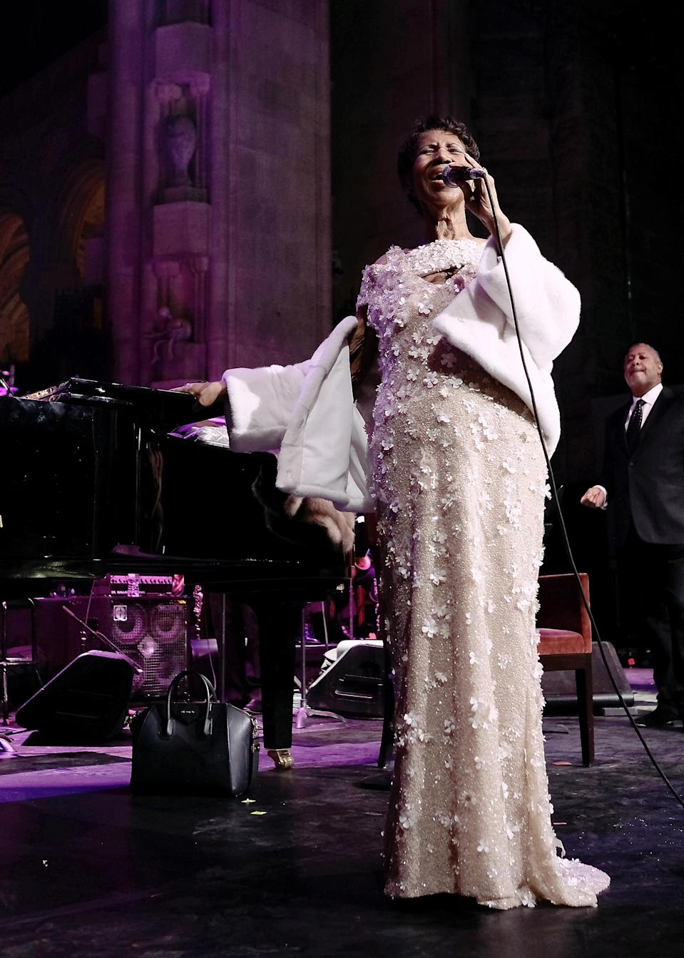 <p>At 75, Aretha Franklin was still going strong wearing a luxurious cream sequin gown decorated with floral appliqués and a white fur coat while performing at the Elton John AIDS Foundation Gala in New York City. (Photo: Getty Images) </p>