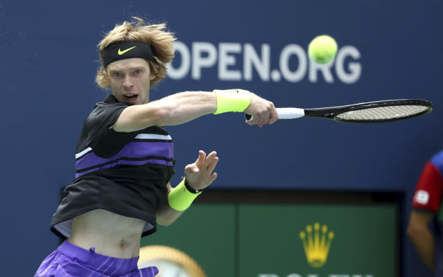 Andrey Rublev, of Russia, returns a shot to Stefanos Tsitsipas, of Greece, during the first round of the US Open tennis tournament Tuesday, Aug. 27, 2019, in New York. (AP Photo/Kevin Hagen)