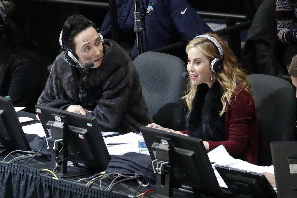 """Announcers Johnny Weir and Tara Lipinski talk during the women's free skate program at the U.S. Figure Skating Championships in Detroit. Tara Lipinski, the 1998 Olympic gold medalist and now the top TV analyst in the sport along with NBC partner Johnny Weir, recognizes how jumbled the figure skating scene is. """"The pre-Olympic season sets the tone of the Olympic season,"""" says Lipinski, who will anchor coverage of Skate America this week on NBC, NBCSN and the Peacock streaming service. (AP Photo/Paul Sancya, File)"""