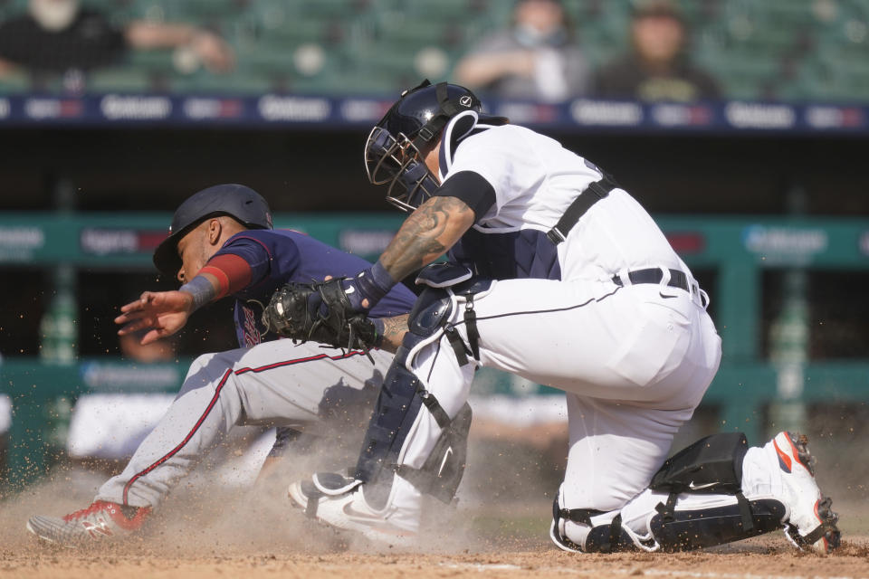 Minnesota Twins' Jorge Polanco is tagged out by Detroit Tigers catcher Grayson Greiner during the tenth inning of a baseball game, Tuesday, April 6, 2021, in Detroit. (AP Photo/Carlos Osorio)