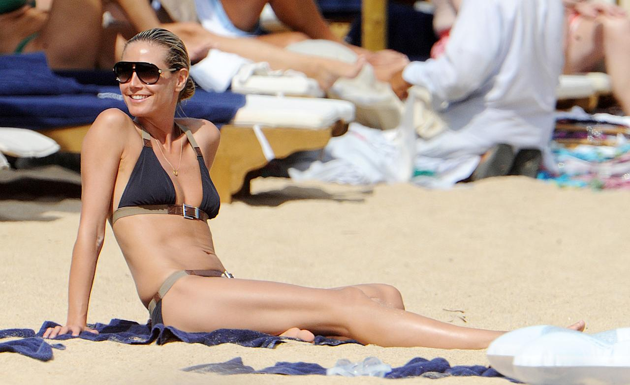 "<b>Heidi Klum</b><br><br>Doesn't it kill you it when stars look just as good in candid shots on the sand as they do touched up on the cover of a fashion mag? ""Project Runway"" host Heidi Klum lays her million-dollar bod out in a chic buckled bikini, putting everyone at the beach in Sardinia, Italy, to shame. Auf wiedersehen, haters!"