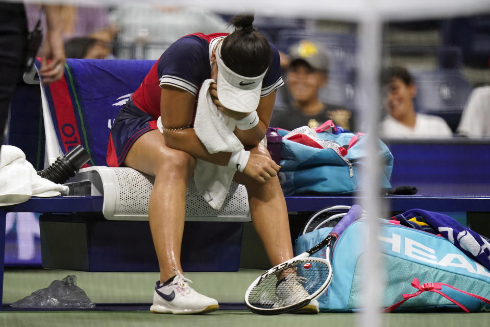 Bianca Andreescu, of Canada, waits for a trainer at a break during the first round of the US Open tennis championships, Tuesday, Aug. 31, 2021, in New York. (AP Photo/Frank Franklin II)