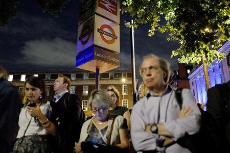 Commuters are seen outside Euston Station after police evacuated the area following a security alert in London, Britain, August 29, 2017.  REUTERS/Tolga Akmen