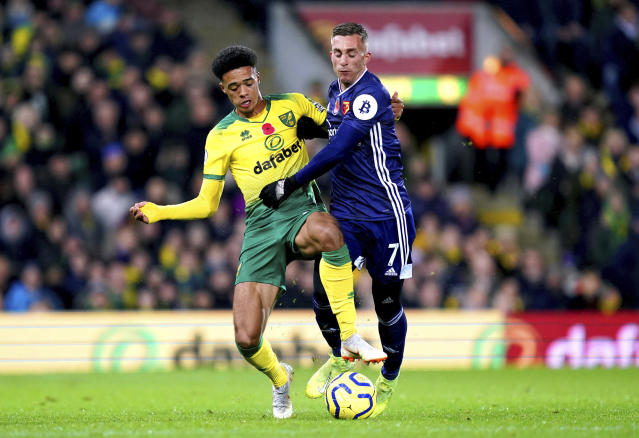 Norwich City's Jamal Lewis, left, and Watford's Gerard Deulofeu battle for the ball during the English Premier League soccer match at Carrow Road, Norwich, England, Friday Nov. 8, 2019. (John Walton/PA via AP)