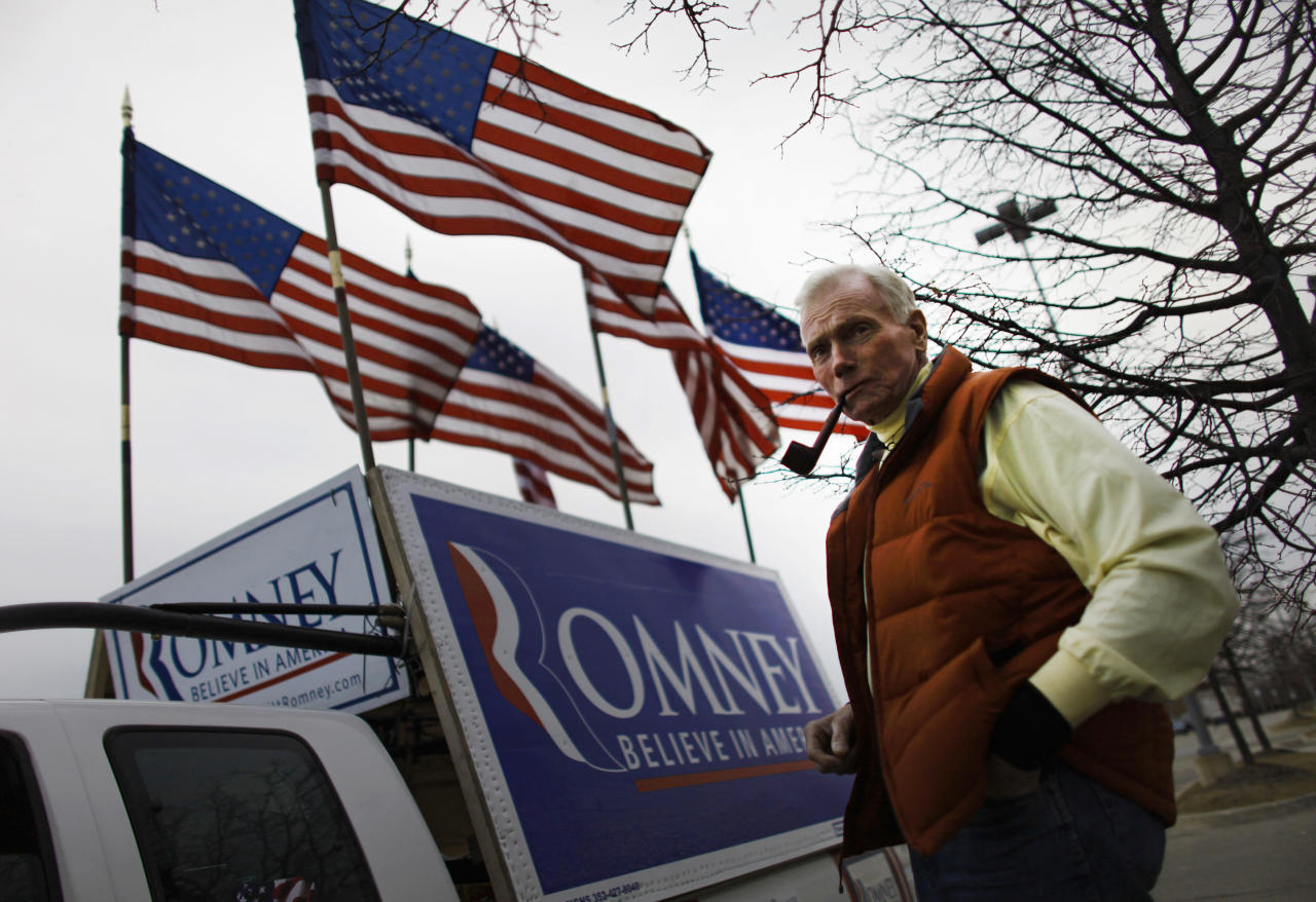 Jim Wilson, a supporter of U.S. Republican presidential candidate Mitt Romney, poses for a portrait in front of his truck displaying signage before the Michigan Primary rally in Novi, Michigan February 28, 2012. REUTERS/Mark Blinch