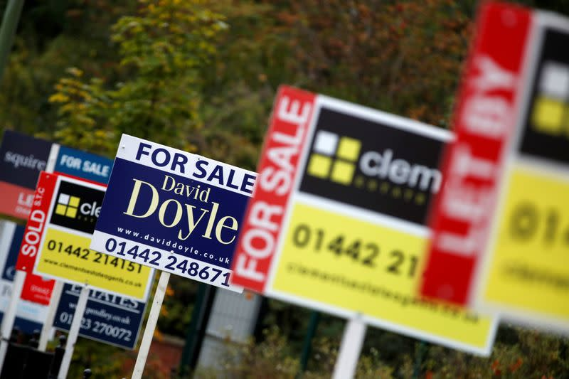 FILE PHOTO: Estate agents' boards are displayed, amid the spread of the coronavirus disease (COVID-19), in Apsley, Hertfordshire
