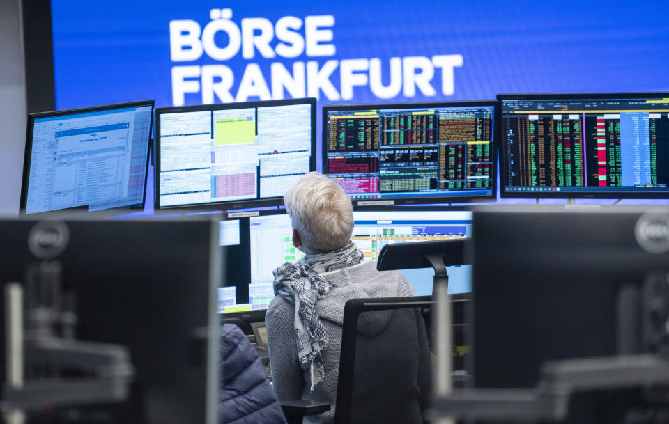 04 November 2020, Hessen, Frankfurt/Main: A trader sits in the trading room of the Frankfurt Stock Exchange in front of her monitors, which also show reports on the election of the US president. Photo: Frank Rumpenhorst/dpa (Photo by Frank Rumpenhorst/picture alliance via Getty Images)