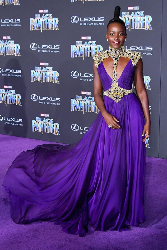 """<h1 class=""""title"""">Lupita Nyong'o</h1> <div class=""""caption""""> Wearing custom Atelier Versace. </div> <cite class=""""credit"""">By Neilson Barnard/Getty Images.</cite>"""