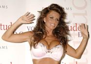 Katie Price (otherwise known as Jordan) is announced as the new face and body of British lingerie label 'Young Attitude' for their autumn/winter 2005/06 collection that offers lingerie for bigger breasts, including a limited edition bra designed especially for this month's Breast Cancer Campaign, Debenhams, Oxford Street, central London, Thursday 13 October 2005. PRESS ASSOCIATION Photo. Photo credit should read: Yui Mok/PA (Photo by Yui Mok - PA Images/PA Images via Getty Images)