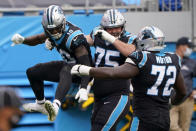 Carolina Panthers wide receiver Curtis Samuel, left, celebrates after scoring with Michael Schofield and Taylor Moton during the second half of an NFL football game against the Detroit Lions Sunday, Nov. 22, 2020, in Charlotte, N.C. (AP Photo/Brian Blanco)