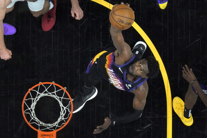 Phoenix Suns center Deandre Ayton rebounds during the first half of game 2 of the NBA basketball Western Conference Finals against the Los Angeles Clippers, Tuesday, June 22, 2021, in Phoenix. (AP Photo/Matt York)