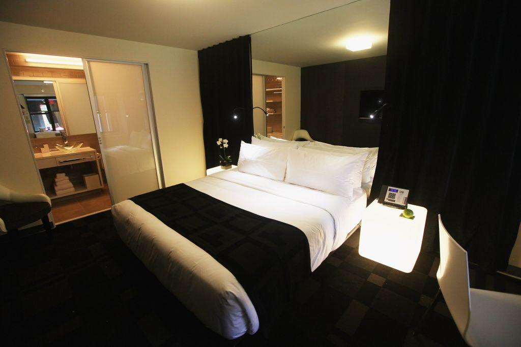 "A room at New York's City's first gay resort hotel, THE OUT NYC.  Rooms at THE OUT NYC start at $250 a night and include wireless high speed Internet, flat-screen TVs, in-room MP3 docking stations, workplaces and mini-bars. Valet parking is available. There are eight ""Sleep Shares"" -- hostel-style rooms that sleep four -- and these are equipped with four full-sized beds, personal TVs, a bathroom, and privacy curtains."